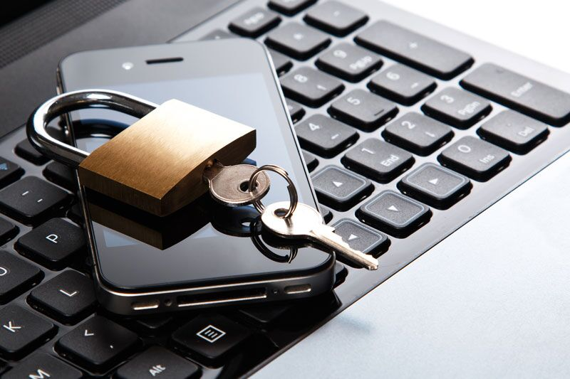 laptop and smartphone protected by padlock